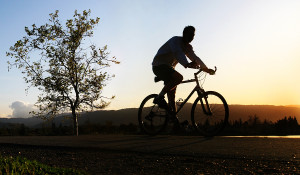 bigstock_Man_Riding_His_Bike_29391