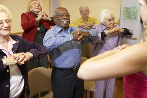 bigstock_Senior_adults_in_a_stretching__13894499